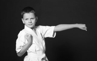 Boy in karate stance in unform